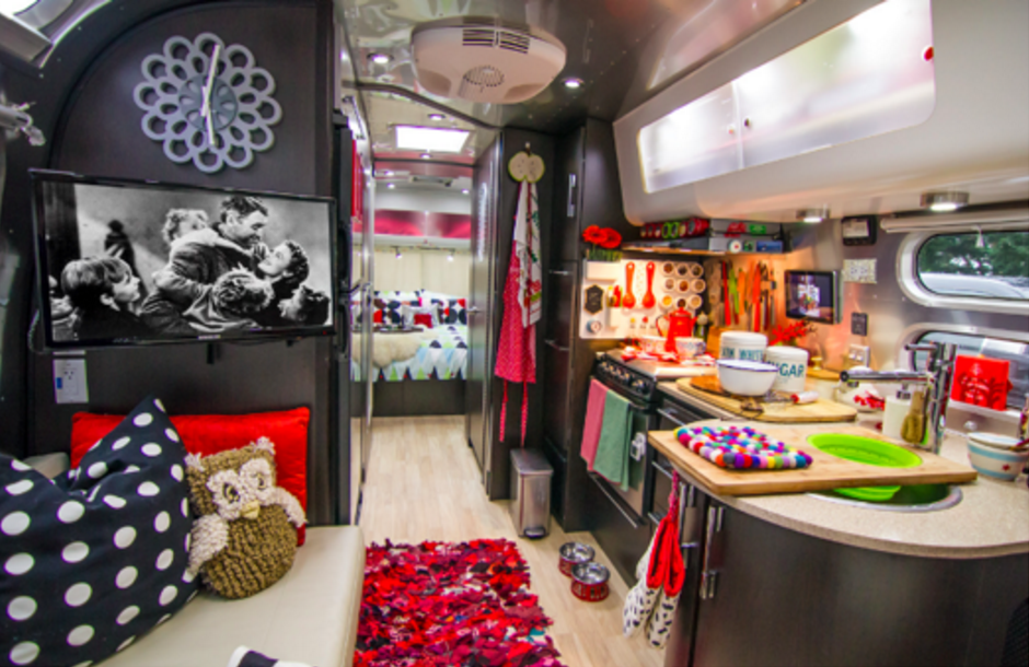 In this part retro, part punk rock Airstream, a hand-woven shag rug –primarily red and black with blue, white, and yellow accents – provide an exciting jolt of color.