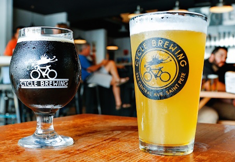 Cycle Brewing in St. Petersburg, Fl. Owner/brewer Doug Dozark. Kraft IPA beer left to right. Creme and Sugar, Please Coffee Porter, Free Wheel Session IPA.